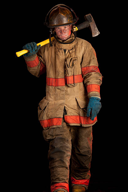 Soot Covered Fireman with Fire Ax stock photo