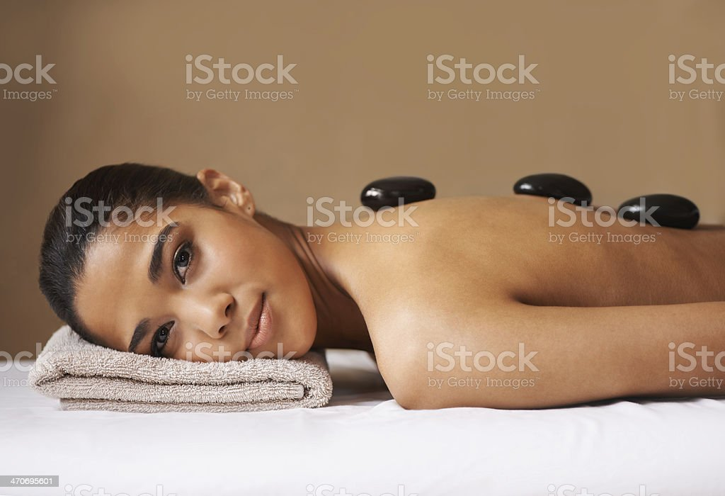Soothing her sore and tense body stock photo