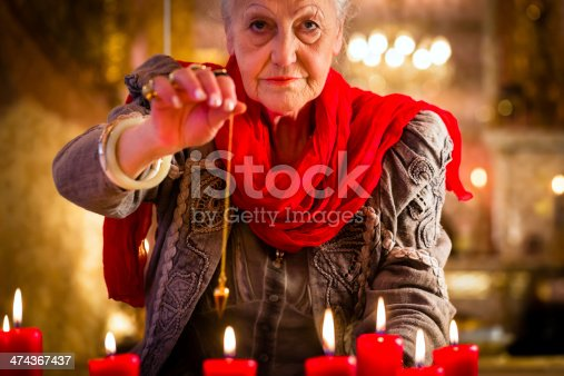 istock Soothsayer during a Seance or session with pendulum 474367437