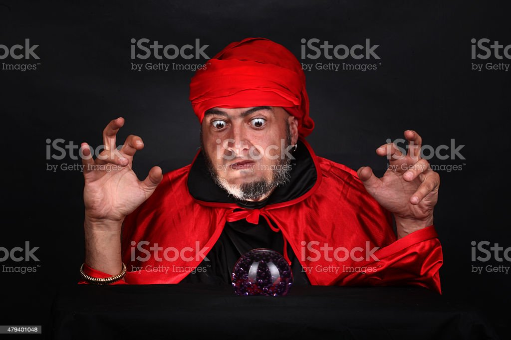 Soothsayer predicts future fortune telling using magic crystal ball stock photo