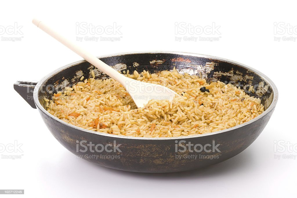Sooty dripping pan of hot pilaf royalty-free stock photo