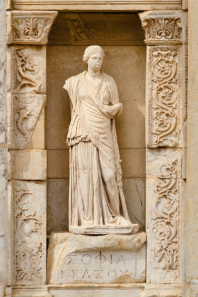 """Sophia in Ephesus, The Wisdom Statue of Sophia in the personification of """"The Wisdom"""" at the Library of Celsus, in Ephesus, Turkey. greco roman style stock pictures, royalty-free photos & images"""