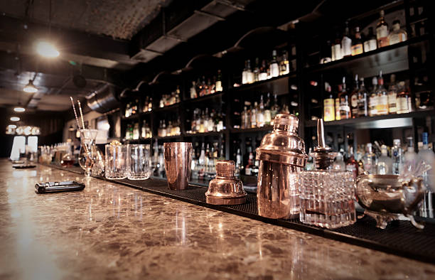 A sophisticated bar counter with copper containers stock photo