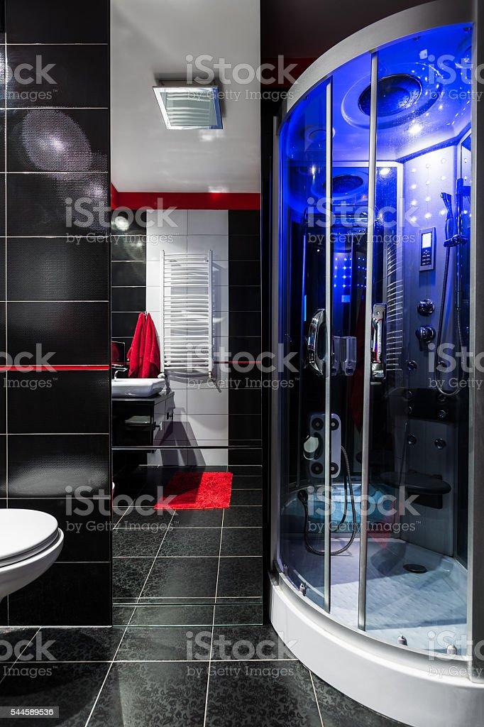 Sophisticated dark bathroom interior stock photo
