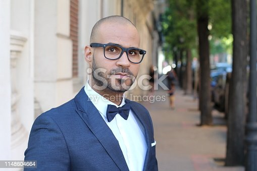 istock Sophisticated ethnic man wearing a tuxedo 1148604664