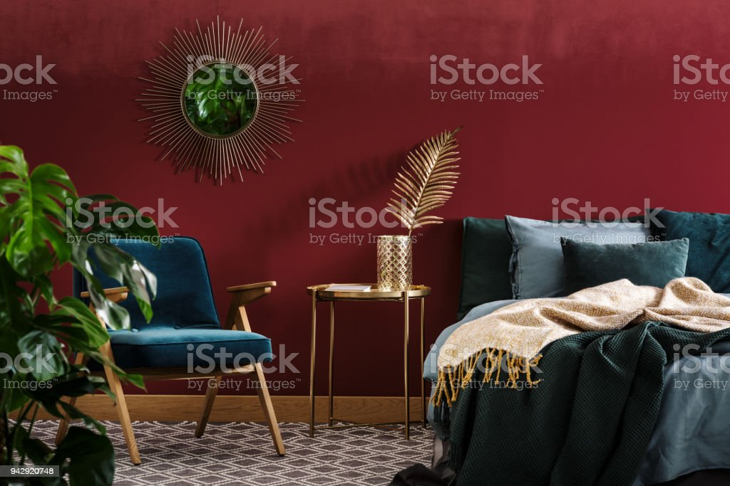 Sophisticated red bedroom with mirror stock photo
