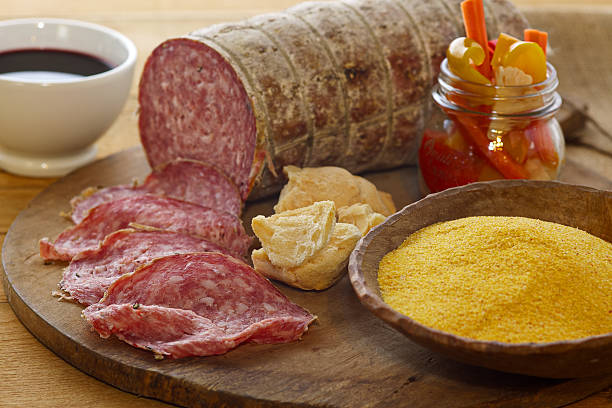 sopressa, pickels,, corn powder and red wine composition - venezien stock-fotos und bilder