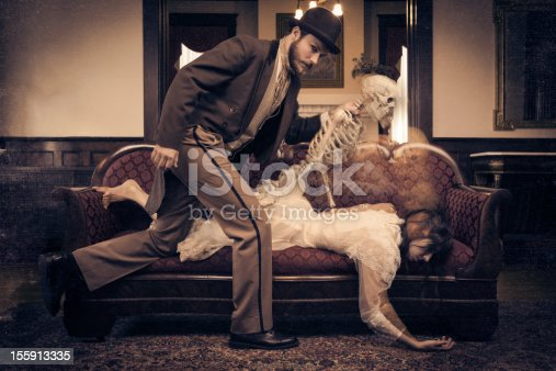 Sorcerer taking woman's soul from her. This stock image has a horizontal composition.