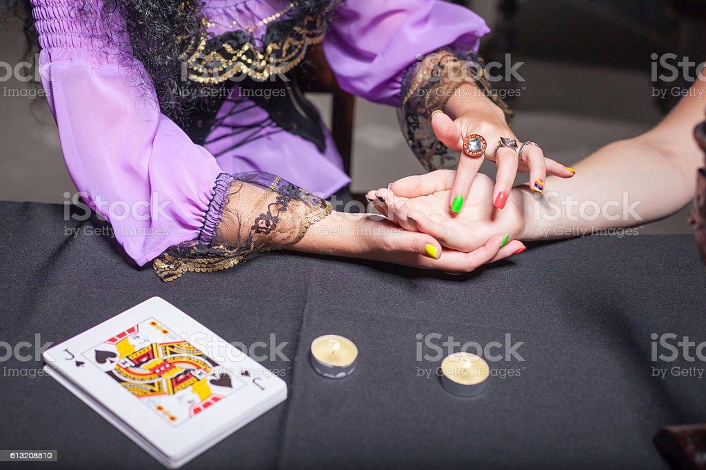 Sorceress reading somebody's hand stock photo