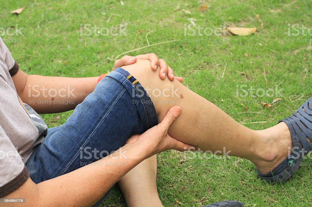 sore leg, knee knee pain stock photo