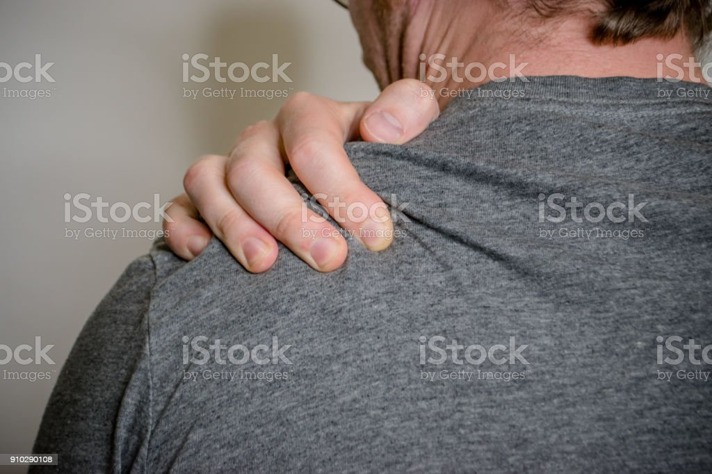 sore shoulder stock photo