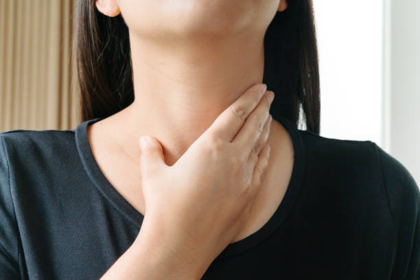 Sore Throat. Beautiful woman hand touching her pain neck. Woman healthcare concept Sore Throat. Beautiful woman hand touching her pain neck. Woman healthcare concept heartburn throat pain stock pictures, royalty-free photos & images