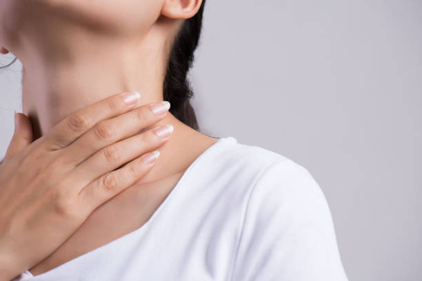 Sore Throat. Closeup Of Beautiful Young Woman Hand Touching Her Ill Neck. Healthcare and medical concept. Sore Throat. Closeup Of Beautiful Young Woman Hand Touching Her Ill Neck. Healthcare and medical concept. throat stock pictures, royalty-free photos & images