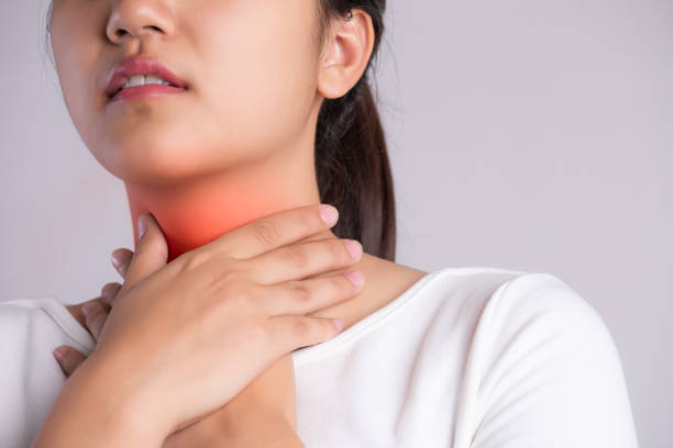 Sore Throat. Closeup Of Beautiful Young Woman Hand Touching Her Ill Neck. Healthcare and medical concept. Sore Throat. Closeup Of Beautiful Young Woman Hand Touching Her Ill Neck. Healthcare and medical concept. heartburn throat pain stock pictures, royalty-free photos & images