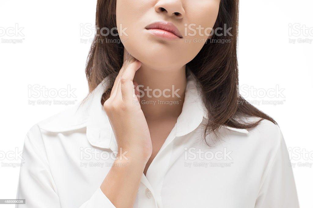 Sore throat woman stock photo