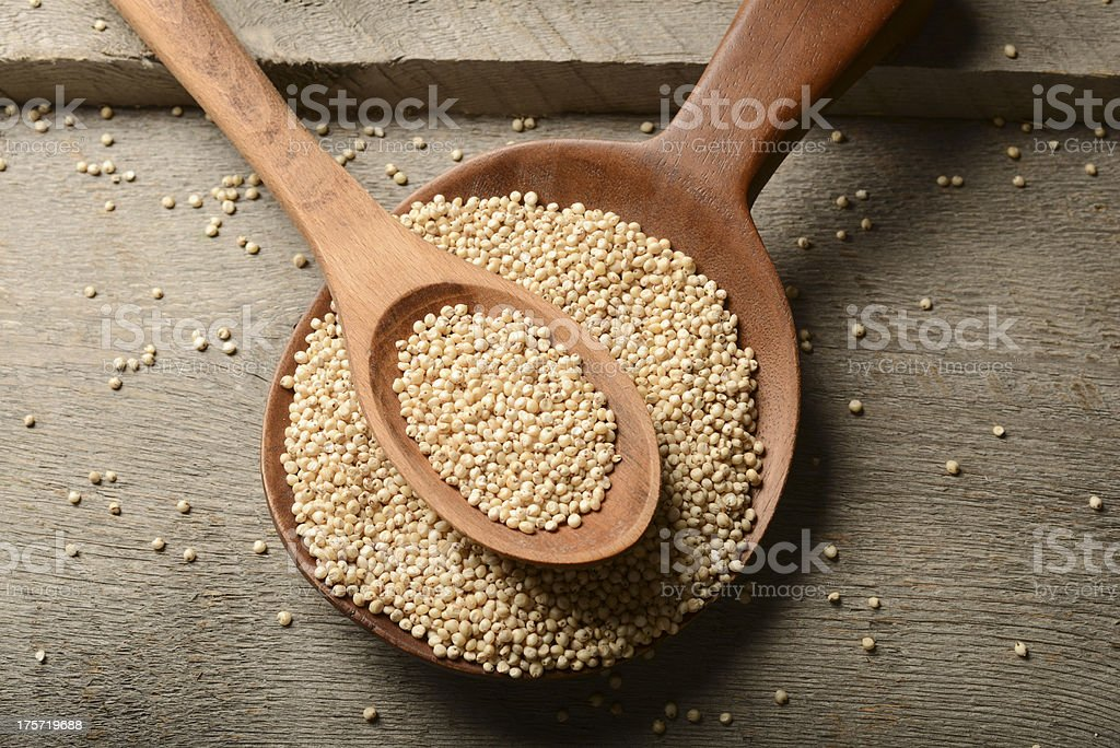 Sorghum  Grains on Wood Background stock photo