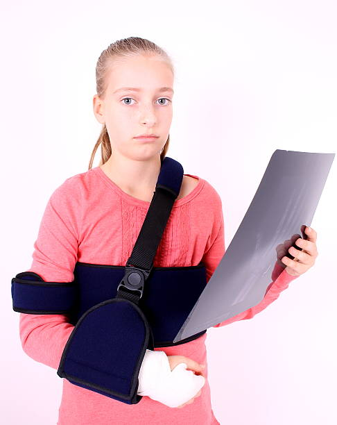sorrowful girl with the x-ray photo - deplorable stock pictures, royalty-free photos & images
