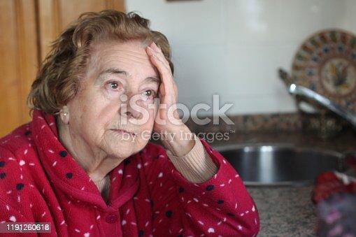 874789168istockphoto Sorrowful senior woman looking away 1191260618