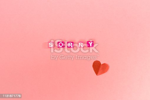 istock sorry  inscription made of colorful cube beads with letters. Festive pink background concept with copy space 1131871776