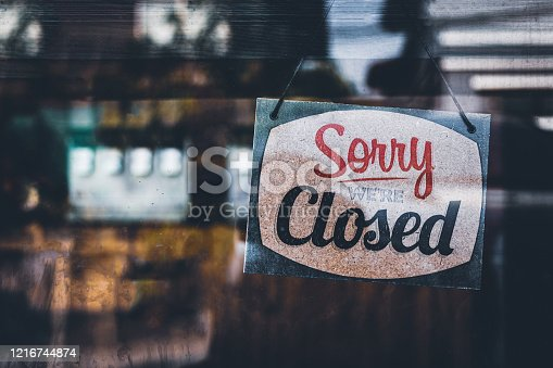 istock Sorry we're closed . grunge image hanging on a cafe window, Coronavirus COVID-19 outbreak lockdown. 1216744874