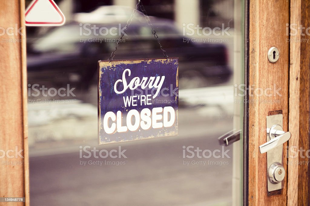 Sorry we're closed sign in a window stock photo
