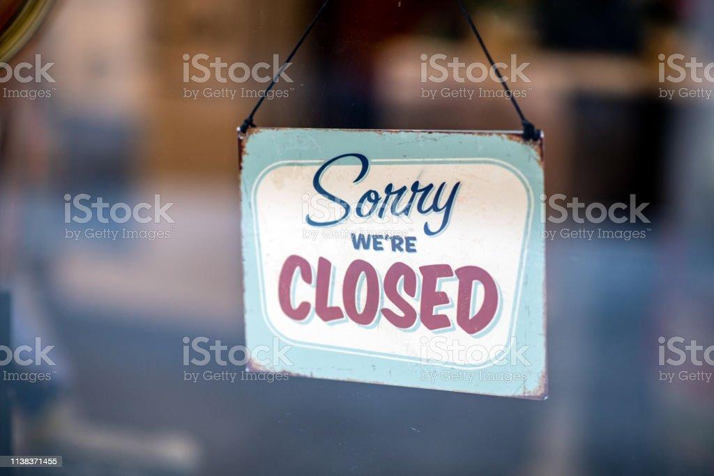 Sorry we\'re closed sign on store window door