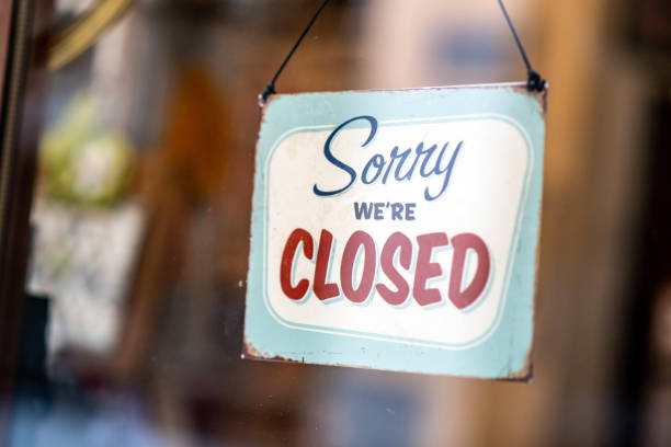 sorry we're closed sign on store window door - closed stock pictures, royalty-free photos & images