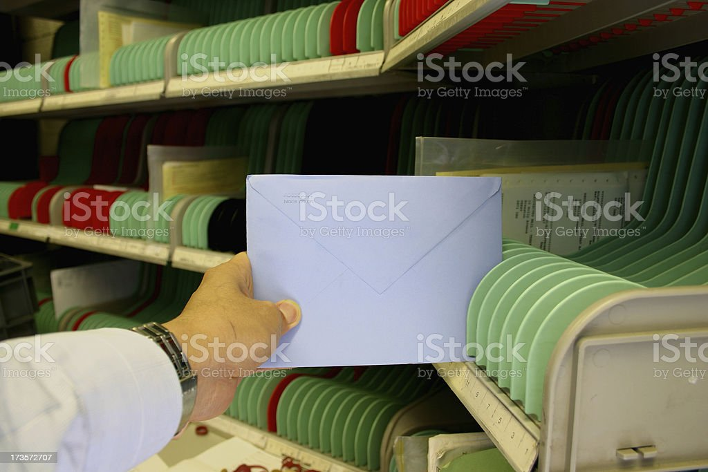 Sorting cards in the mail room stock photo