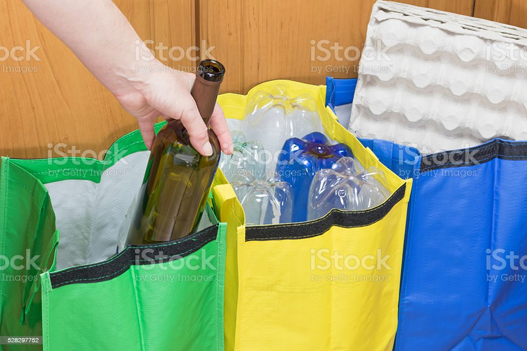 Sorting glass waste stock photo