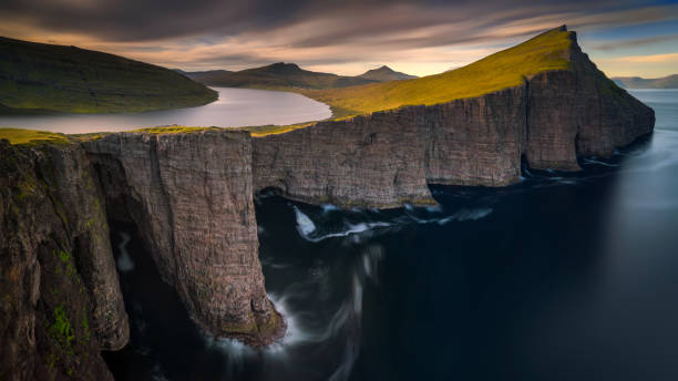 Sorvagsvatn lake Sorvagsvatn lake on cliffs of Vagar island in sunset, Faroe Islands northern europe stock pictures, royalty-free photos & images