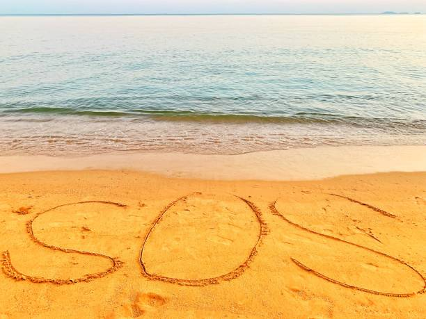 sos draw in the beach stock photo
