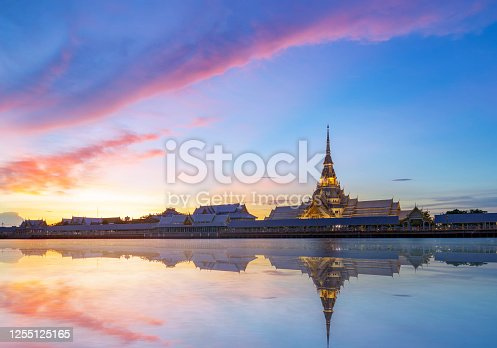 View of Sothon Wararam Worawihan temple, next to the Bang Pakong River in the beautiful sunset time at Chachoengsao province Thailand