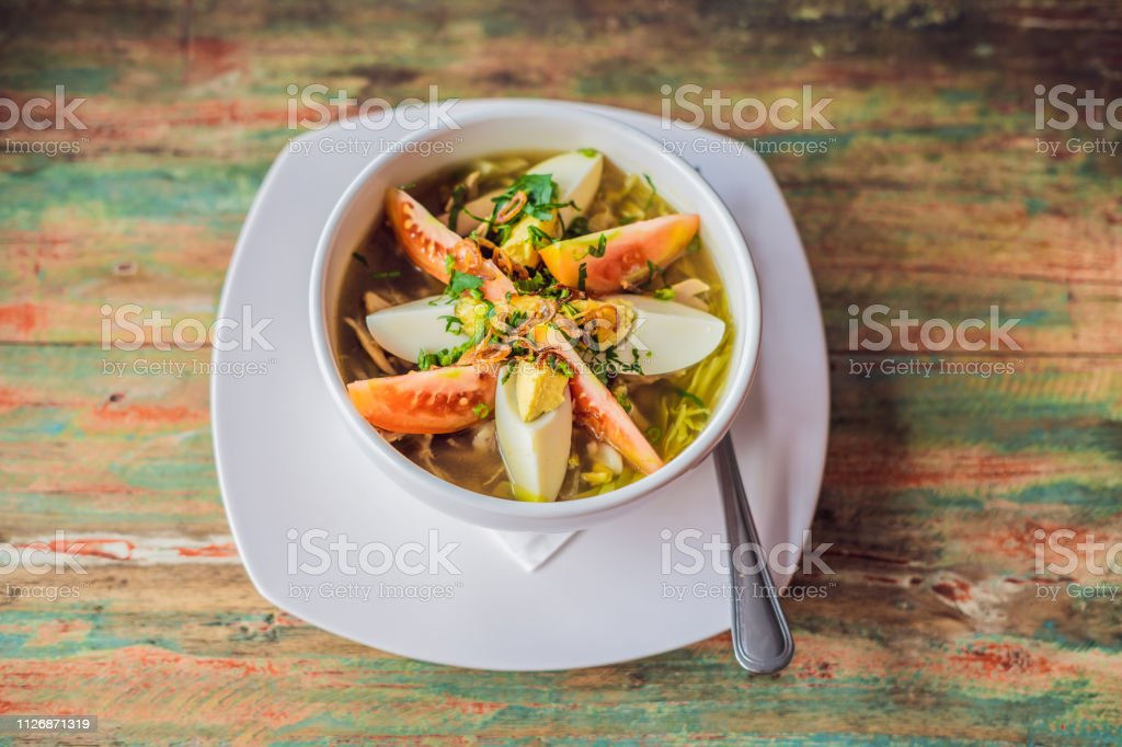 Soto is a traditional Indonesian soup mainly composed of broth, chicken and vegetables stock photo