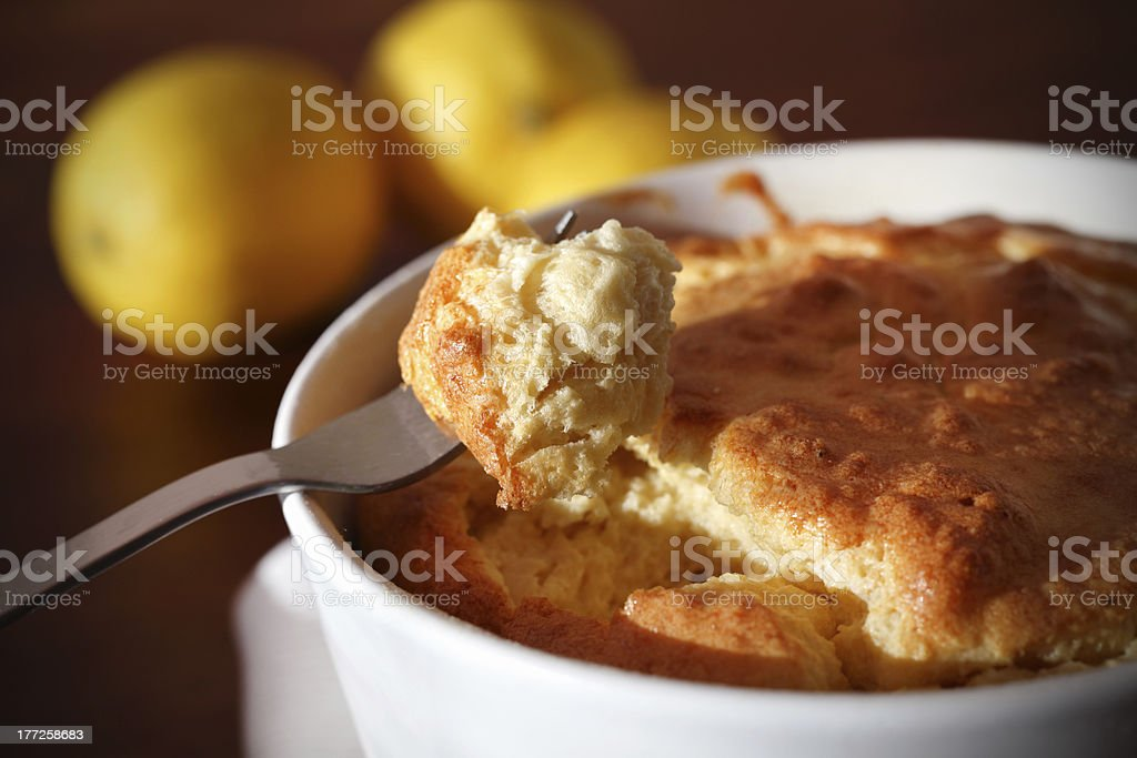 Soufflé with cheese on a fork, eating stock photo