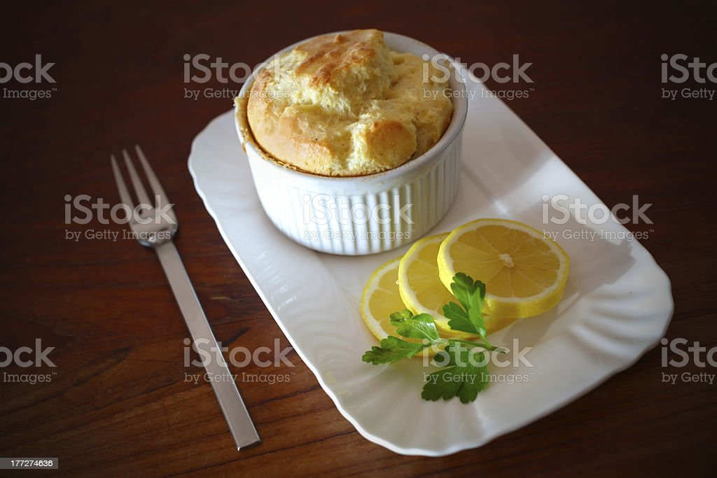 Soufflé with slices of lemons stock photo