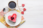 istock souffle cake in the form of heart  with cup of coffee on a wooden table 1093204200