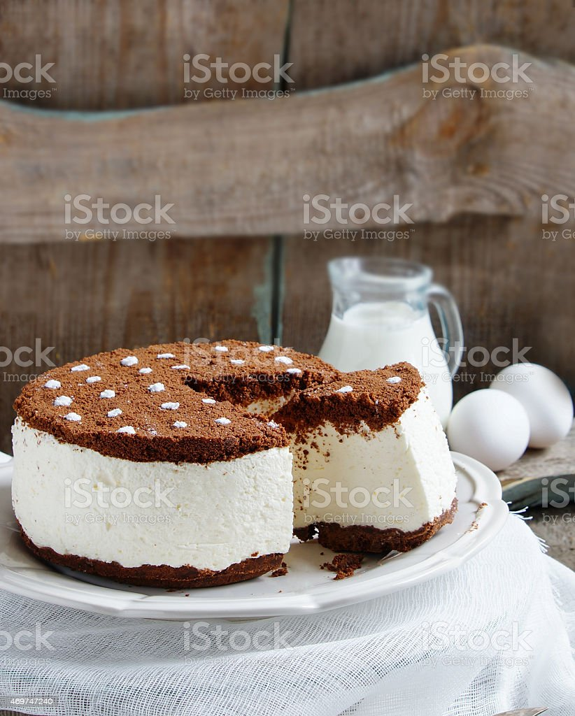 souffle cake with cream and chocolate cookie crumbs stock photo