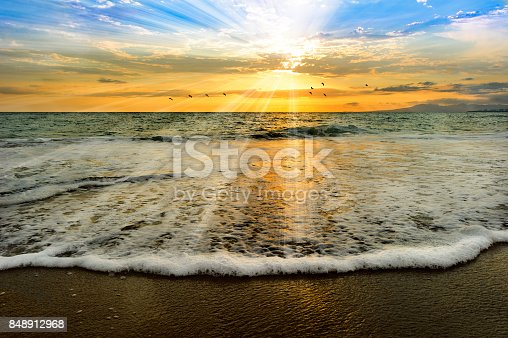 Soul ocen light baptism sunset is an ocean scenci sunset with a bathing solul light of rays coming down from the heavens like a baptism.