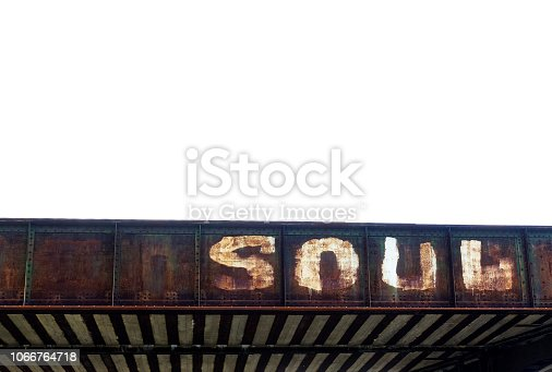 A funky looking train bridge with the word Soul written on it.
