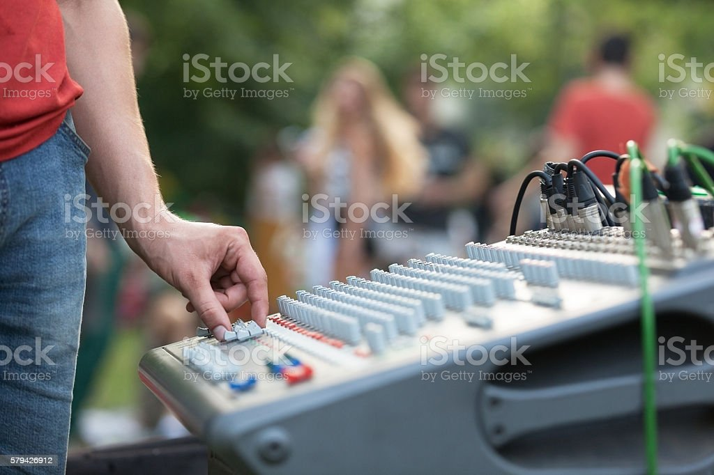Sound control engineer at outdoor music performance stock photo