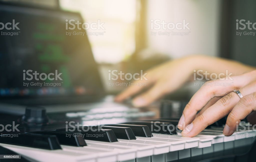 Sound engineer finishing work putting down headphone stock photo