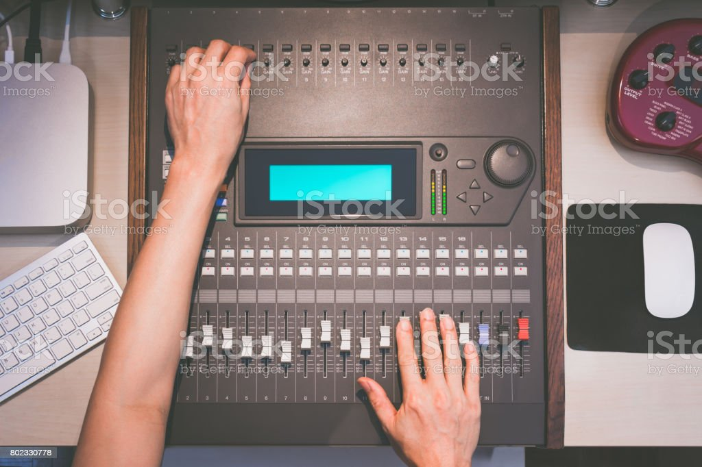 sound engineer hands working on digital sound mixer, music recording concept stock photo