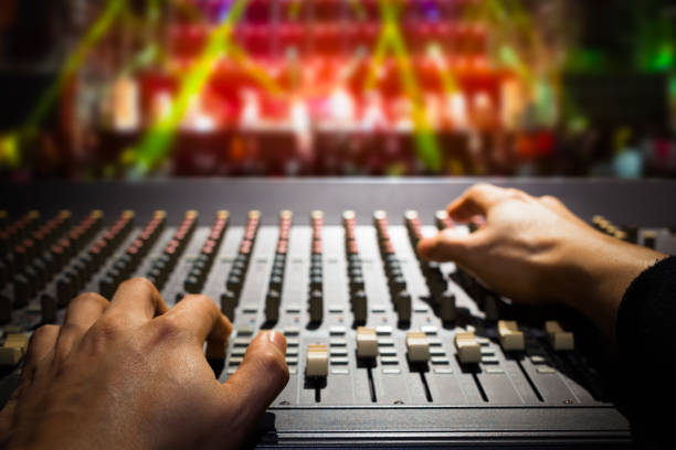 sound engineer hands working on sound mixer, background of concert stage sound engineer hands working on sound mixer, background of concert stage sound mixer stock pictures, royalty-free photos & images