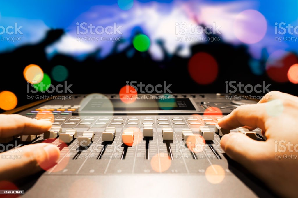 sound engineer hands working on sound mixer in live concert stock photo