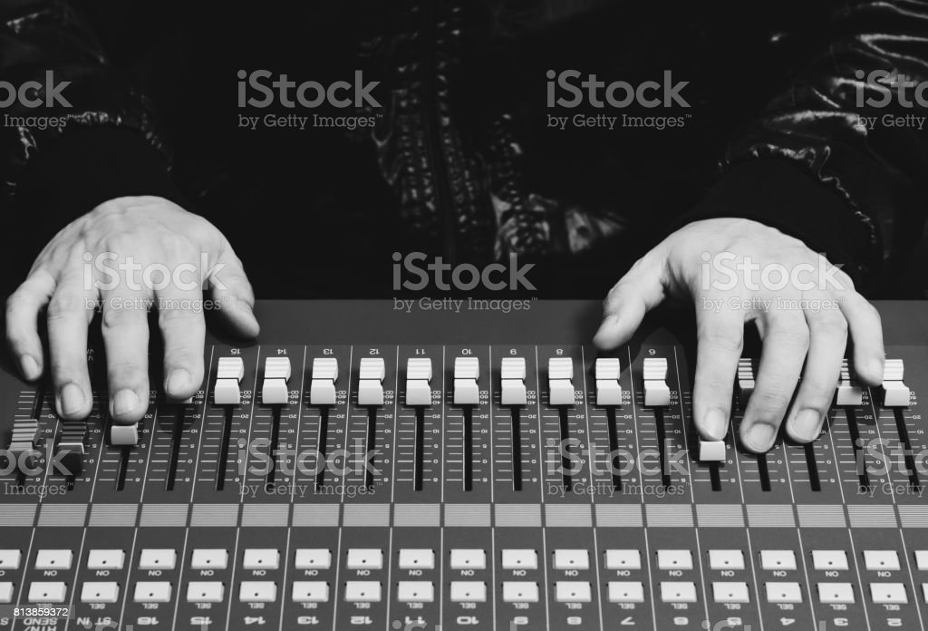sound engineer hands working on sound mixer stock photo