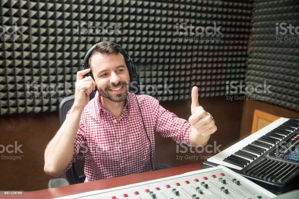Sound engineer happy with audio output stock photo