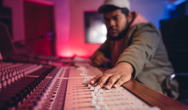 sound engineer working on music mixer - producer stock pictures, royalty-free photos & images