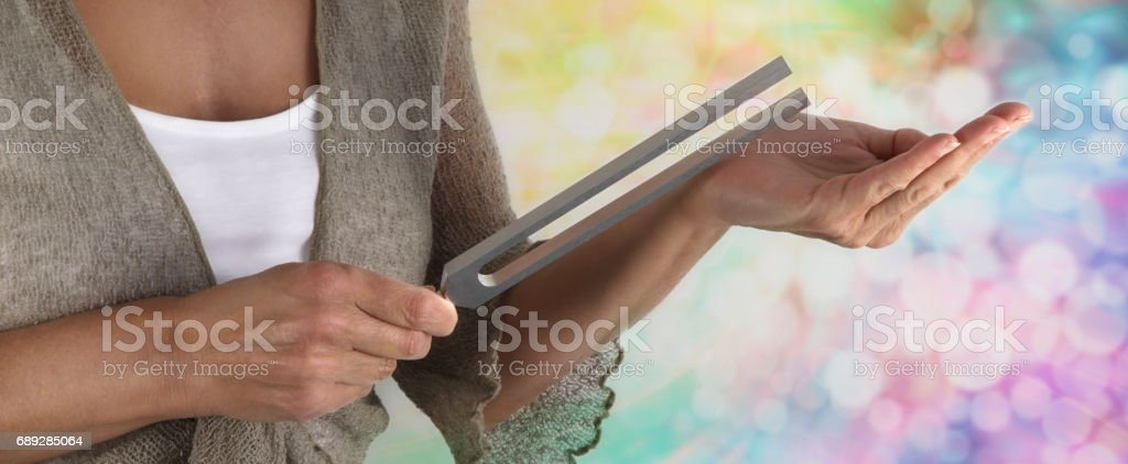 Sound Healer Using a Tuning Fork stock photo
