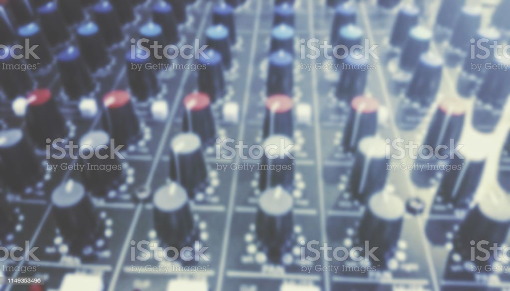 Sound Mixer, Audio Mixer Slide. Music equipment blurred background.