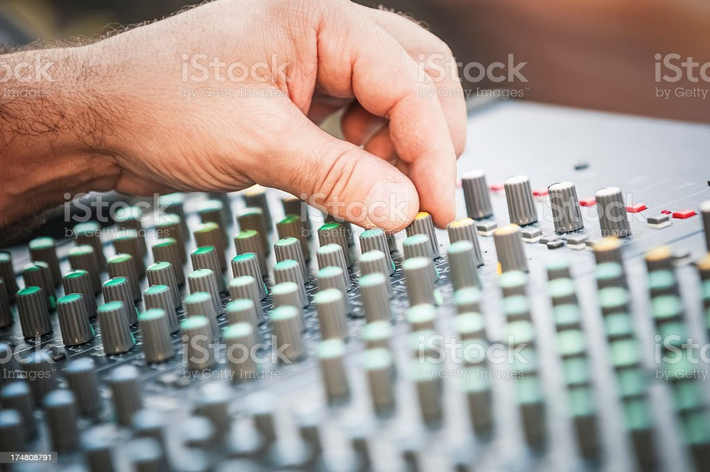 Sound mixer close up with hand stock photo
